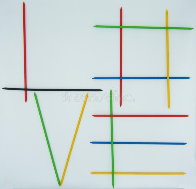 Die Wort Liebe geschrieben durch shangai Stöcke, Positivenesskonzept lizenzfreie stockfotografie