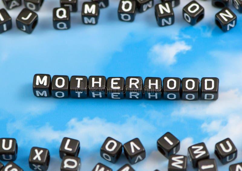 Die Wort Mutterschaft lizenzfreie stockfotos