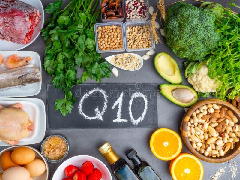 Die Zusammensetzung mit Lebensmitteln enthält das Coenzym Q10, Antioxidans, die Energie in die Zelle, Produkte gegen freie Radika lizenzfreie stockfotografie