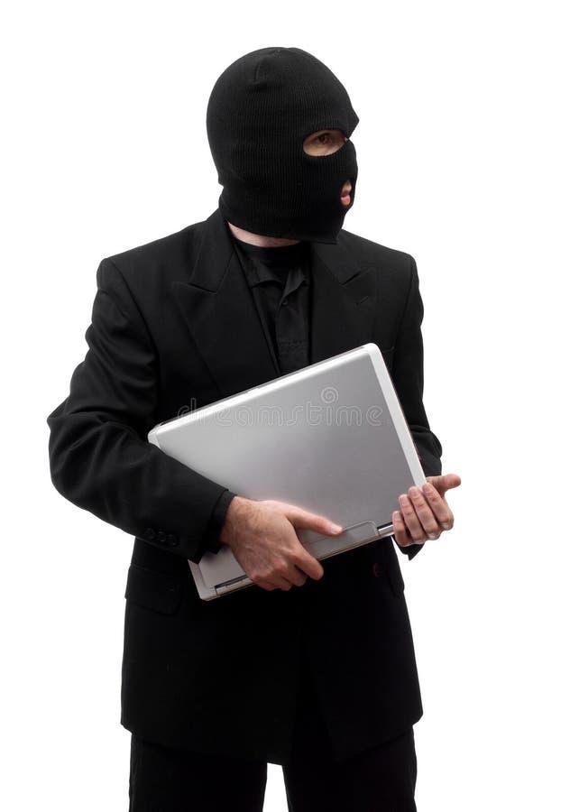Dieb, der Laptop stiehlt stockbild