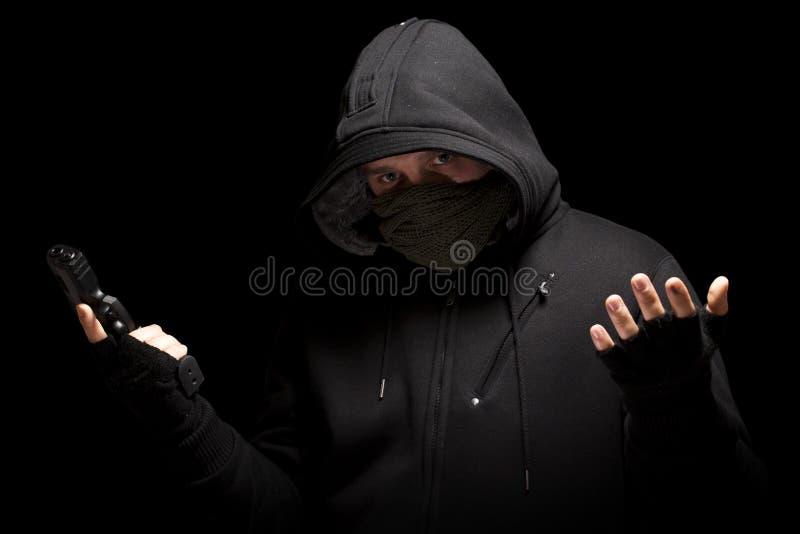 Dieb mit Gewehr stockbilder