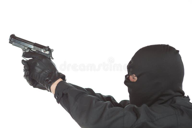 Dieb mit Gewehr stockfoto
