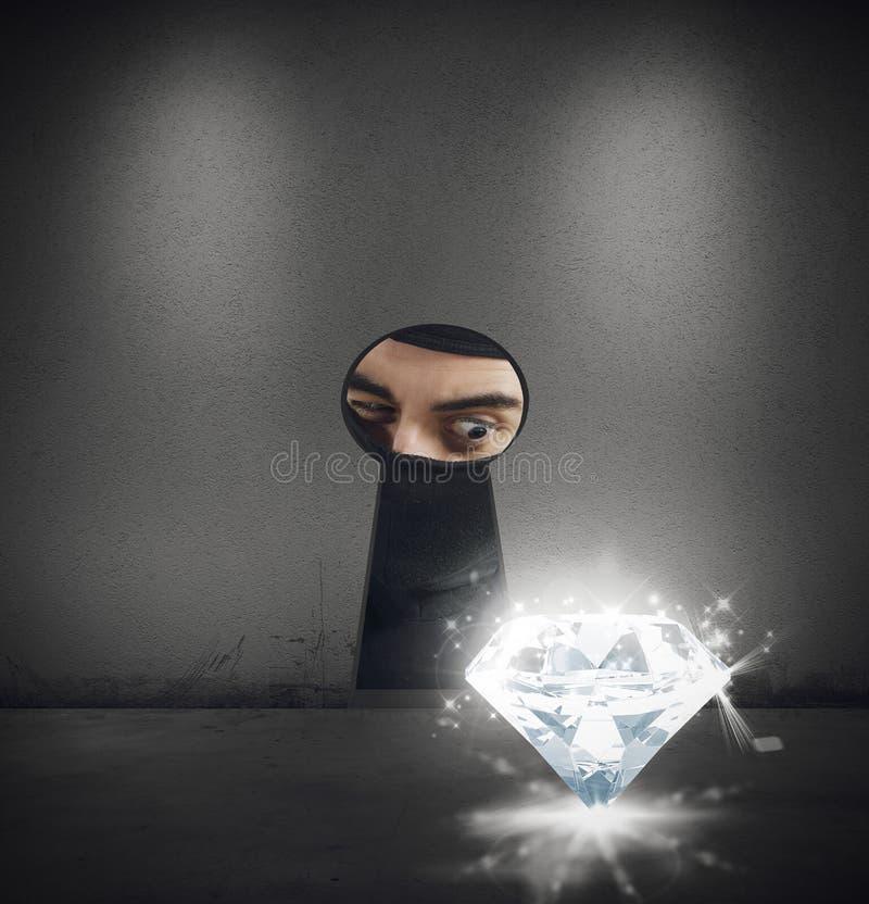 Dieb stiehlt einen Diamanten stockbild