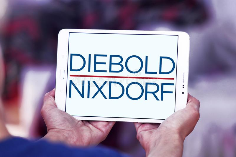 Diebold Nixdorf financial services company logo. Logo of Diebold Nixdorf on samsung tablet. Diebold Nixdorf is an American financial self service, security and royalty free stock image