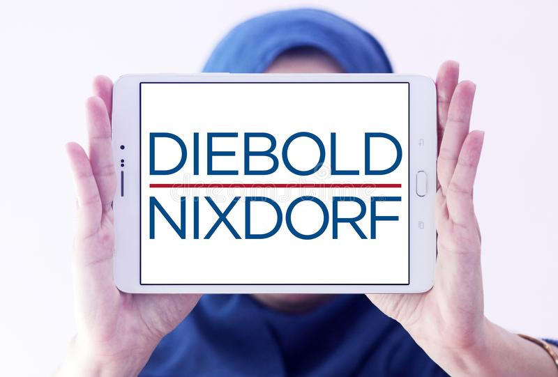 Diebold Nixdorf financial services company logo. Logo of Diebold Nixdorf on samsung tablet holded by arab muslim woman. Diebold Nixdorf is an American financial royalty free stock photos