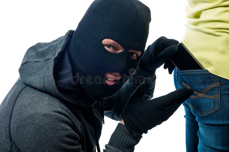 Diebstahl des Telefons von den Gesäßtaschejeans stockbilder