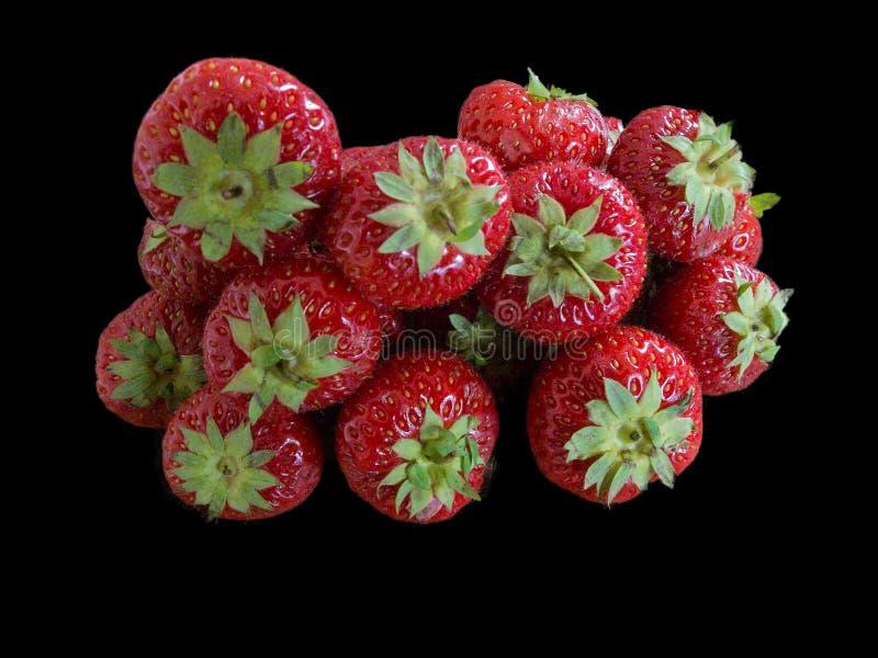 Dieciocho fresas aisladas en fondo negro foto de archivo libre de regalías