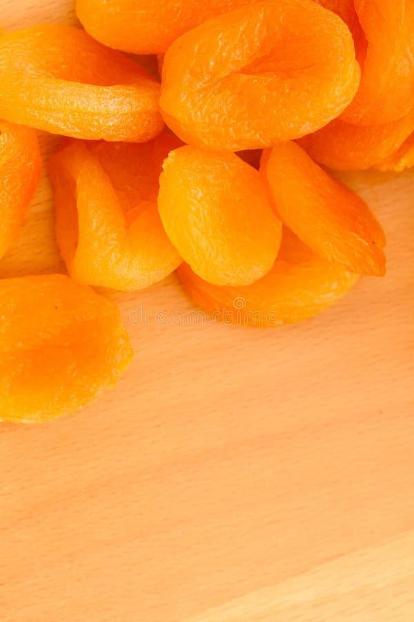 Dieet Abrikozen droge vruchten als voedselachtergrond stock afbeelding
