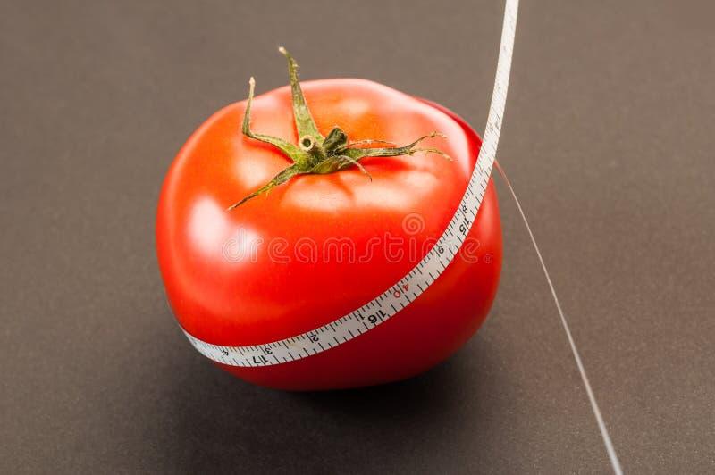 Dieet met rood tomatenconcept stock fotografie