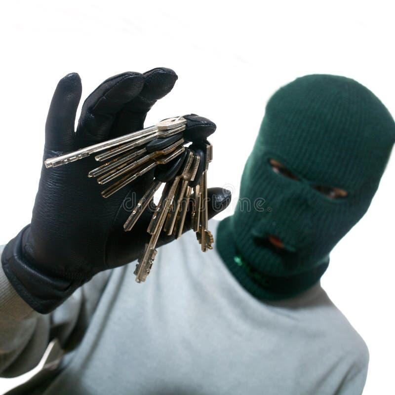 Dief met sleutels stock foto