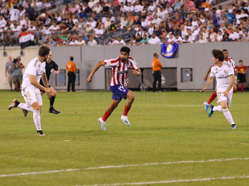 Diego Costa de Atletico de Madrid #19 en la acción durante partido contra Real Madrid en la taza de 2019 campeones internacional foto de archivo libre de regalías