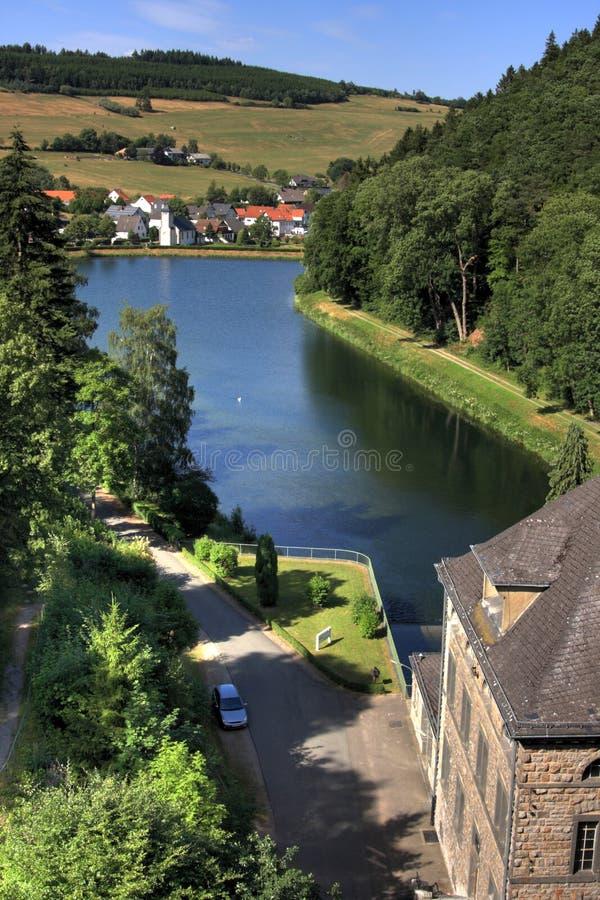 Diemel dam. MARSBERG, GER -AUGUST 14, Hydropowerstation and dam at lake Diemelsee, Helminghausen in the background, Marsberg Helminghausen, Germany, August 14