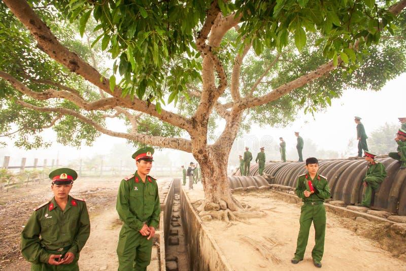 Young Vietnamese soldier during site visit program of Vietnamese. Dien Bien Phu, Vietnam – FEBRUARY 26, 2012: Young Vietnamese soldier during site visit royalty free stock photo