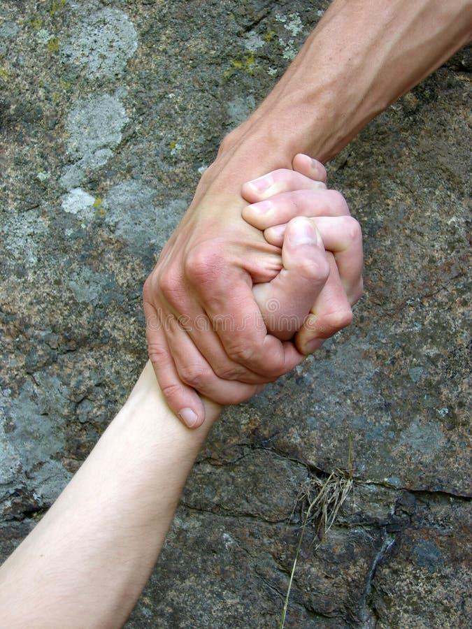 Dien een hand in stock foto