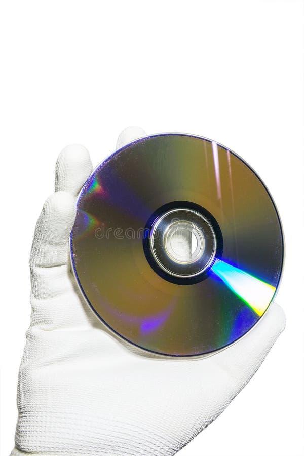 Dien een witte handschoen in houdend compact disccd royalty-vrije stock foto's