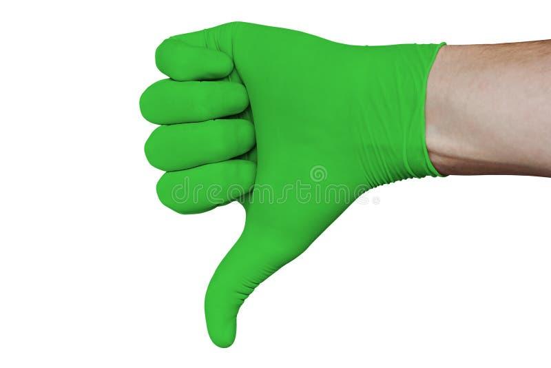Dien groene medische handschoen in die het teken tonen die van afkeuringsduimen neer op witte achtergrond wordt geïsoleerd stock afbeelding