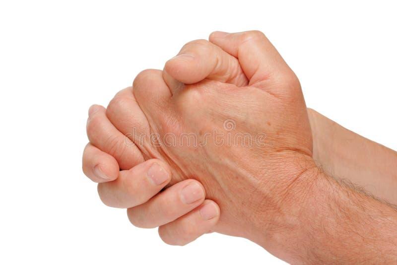 Dient een positie van het bidden in stock foto