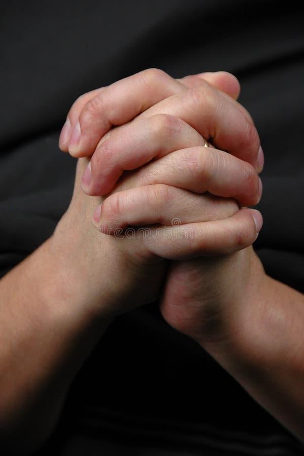 Dient gebed in stock afbeelding