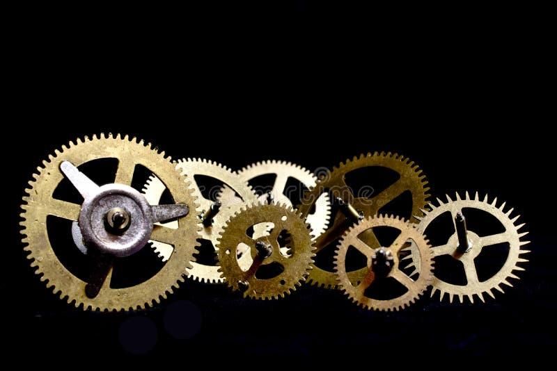 Dientes del reloj de Steampunk en fondo negro fotos de archivo libres de regalías