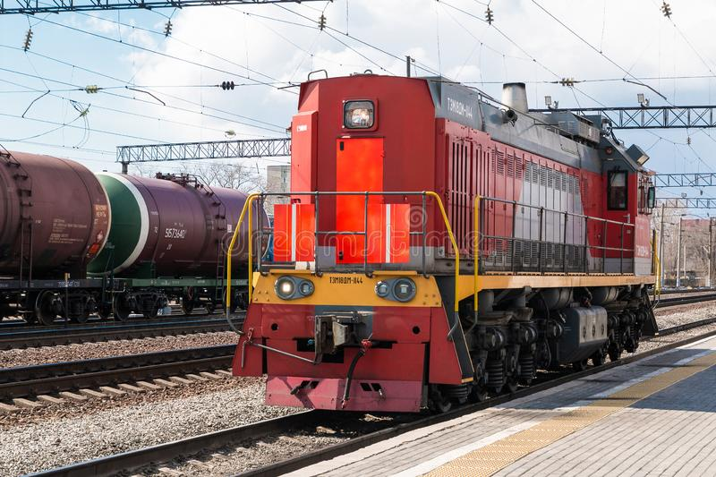 Diesel electric shunting locomotive switcher  Cargo going solo on the track. Front view stock images
