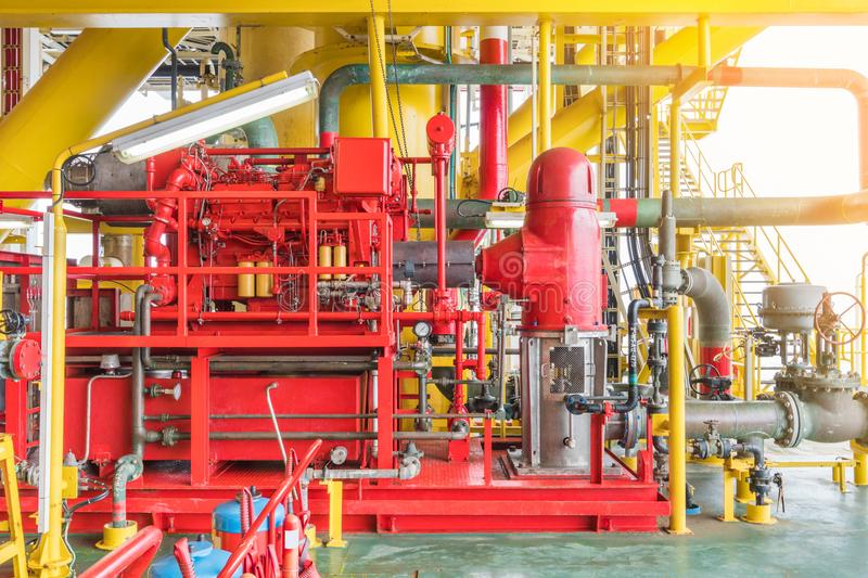Diesel engine fire water pump at offshore oil and gas construction platform. stock photos