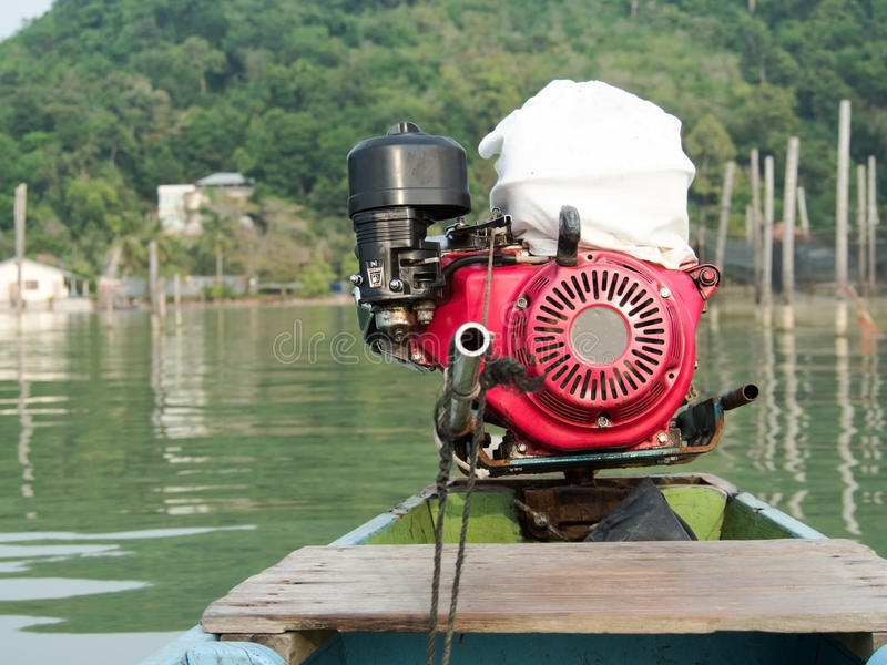 Diesel engine of Thai traditional long tail boat in sea with mountain background stock image