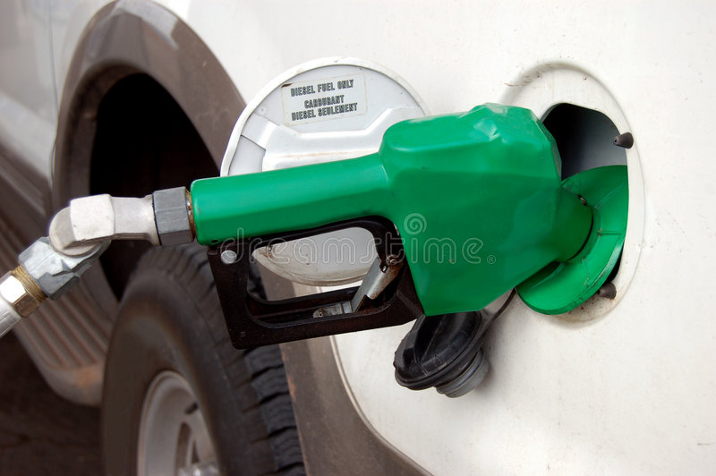 Diesel Fuel Only. Filling up a SUV with diesel fuel royalty free stock images