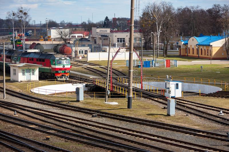 Diesel locomotive at entrance to railway turntable in railway depot on sunny spring day royalty free stock photo