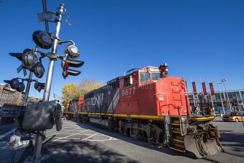 Diesel locomotives with the CN logo shunting. Also known as Canadian National Railway, it is the main cargo rail operator. MONTREAL, CANADA - NOVEMBER 4, 2018 stock photography