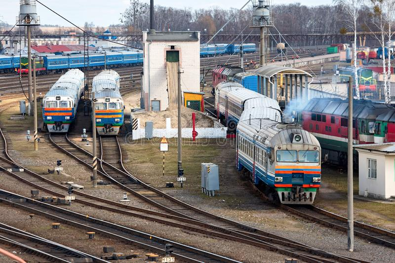 Diesel locomotives with wagons are in the depot with railroad arrows and rails. Ð¡oncept of passenger transportation and travel.  stock photo