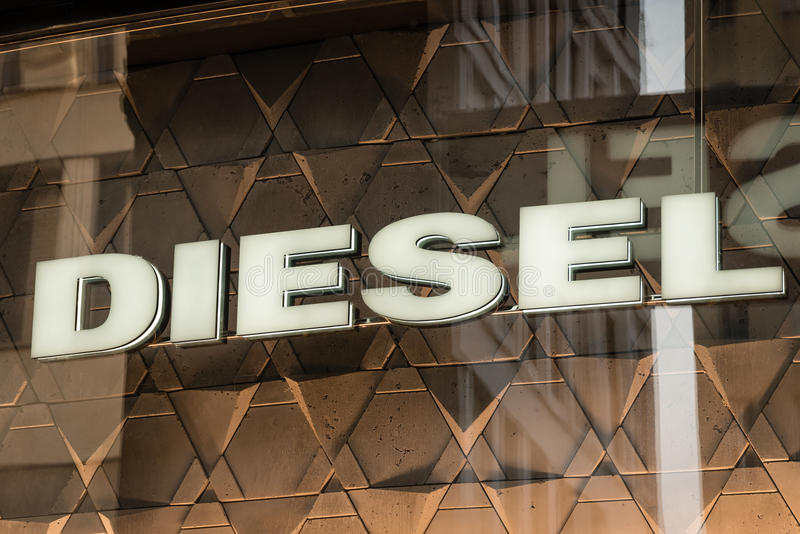 Diesel logo. Milan, Italy - October 9, 2016: Shop window and entrance of a Diesel shop in Milan, Italy. Few days after Milan Fashion Week. Fall Winter 2017 stock photography