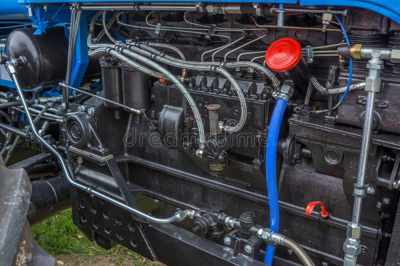 Diesel power engine at new tractor. Black Diesel power engine at new tractor royalty free stock photography