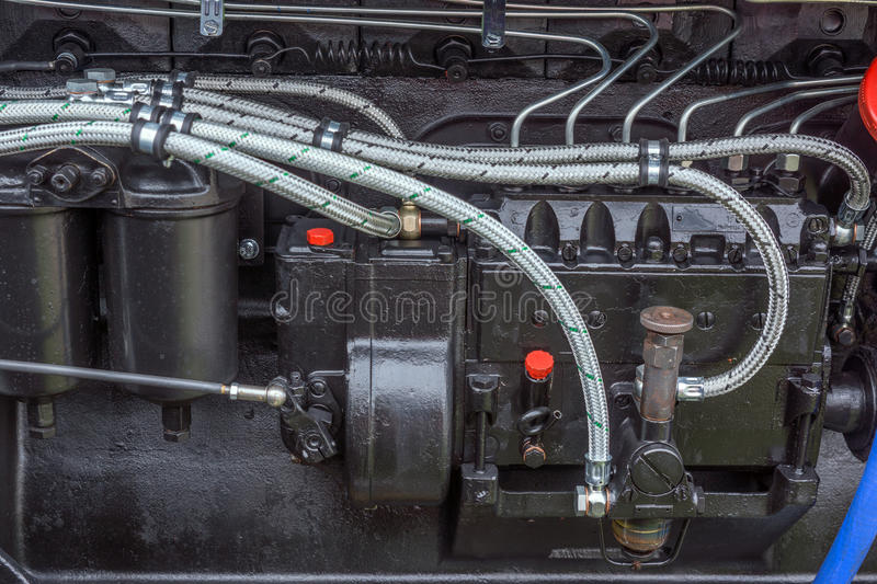 Diesel power engine at new tractor. Black Diesel power engine at new tractor stock photos