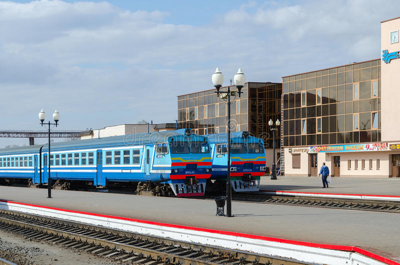 Diesel trains on the ways of train station in Mogilev, Belarus. MOGILEV, BELARUS - APRIL 25, 2015: Unidentified man is waiting to board in diesel trains on the royalty free stock images
