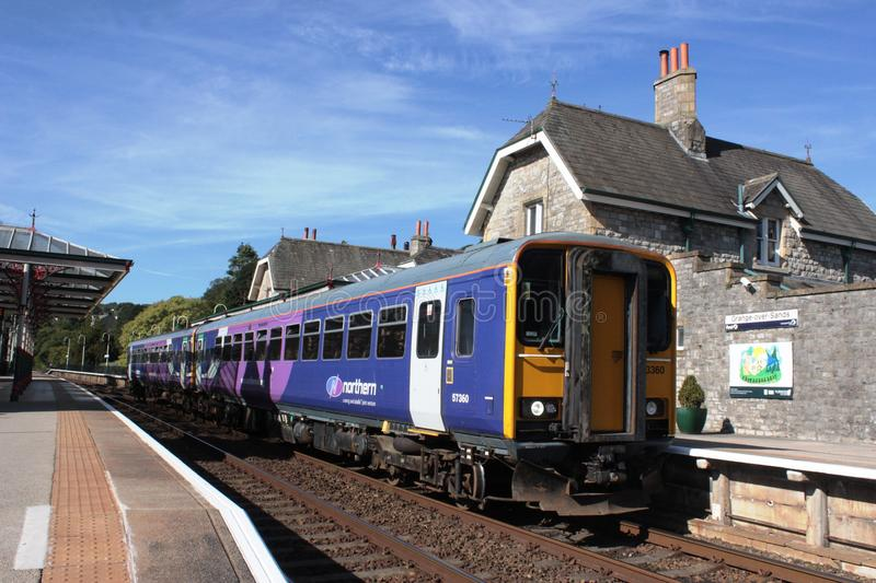 Diesel units at Grange-over-Sands railway station. Two class 153 diesel units running together on a service to Lancaster along the Furness railway line from stock photo