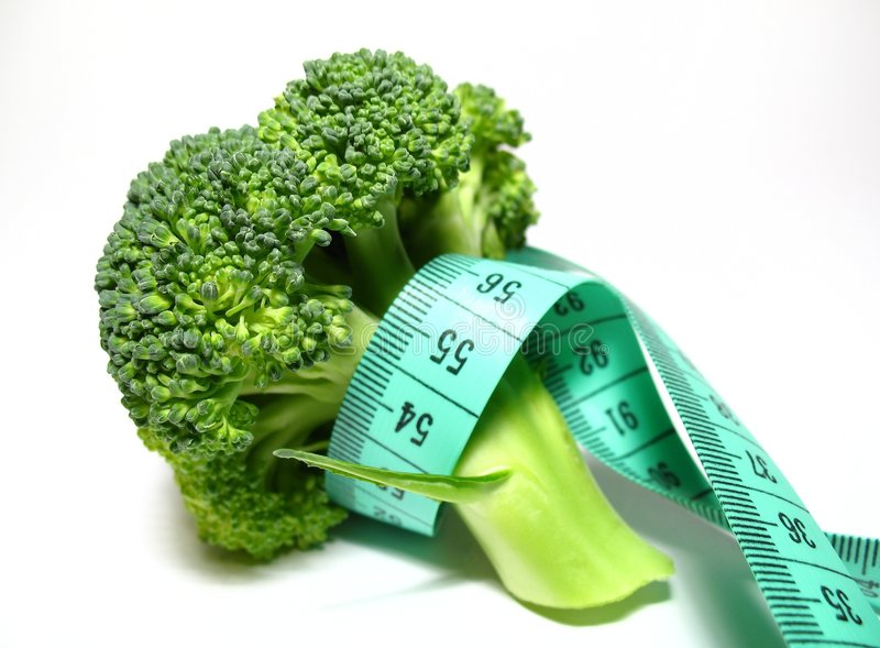Diet. Broccoli diet, detail broccoli with meter royalty free stock photos
