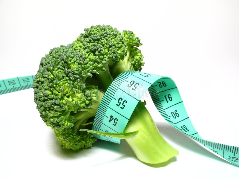 Diet. Broccoli diet, detail broccoli with meter stock image