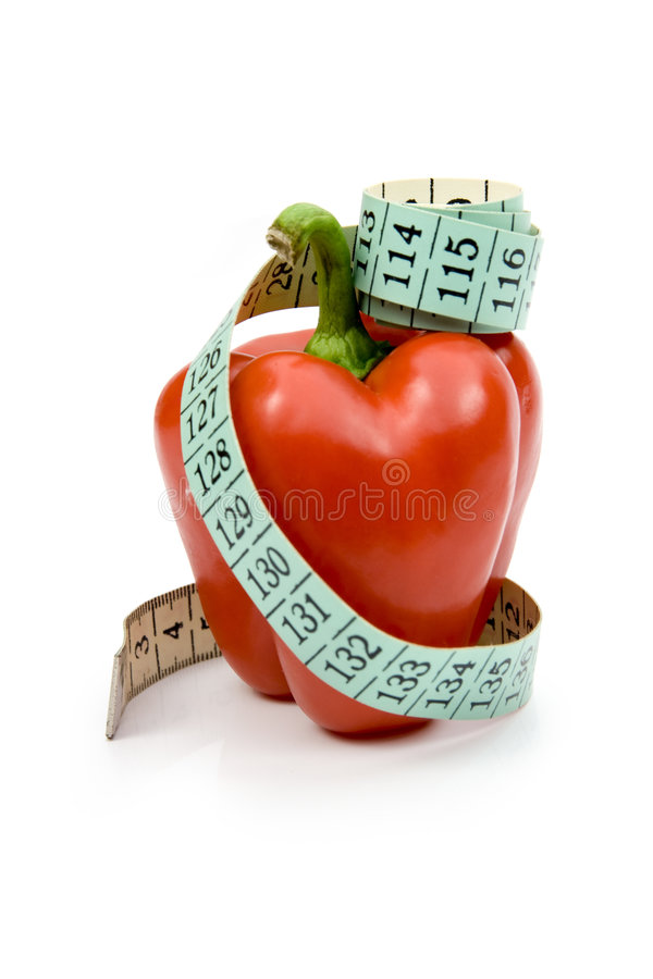 Diet. Red pepper with measuring-tape - metaphor lowering (reducing) diet - grow slim stock photography