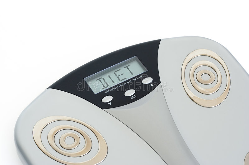 Diet. Bathroom scale showing DIET on its display stock images