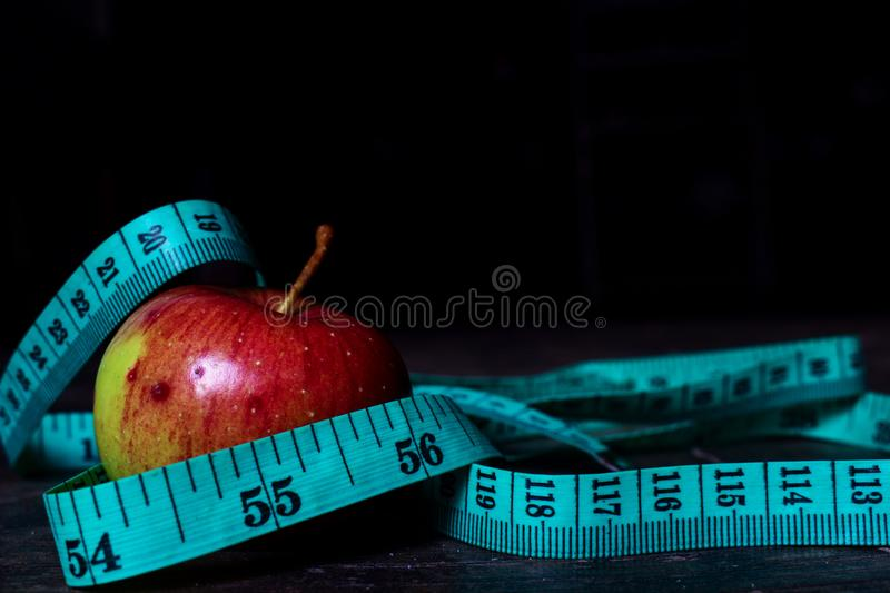 Diet apple with measuring tape stock images