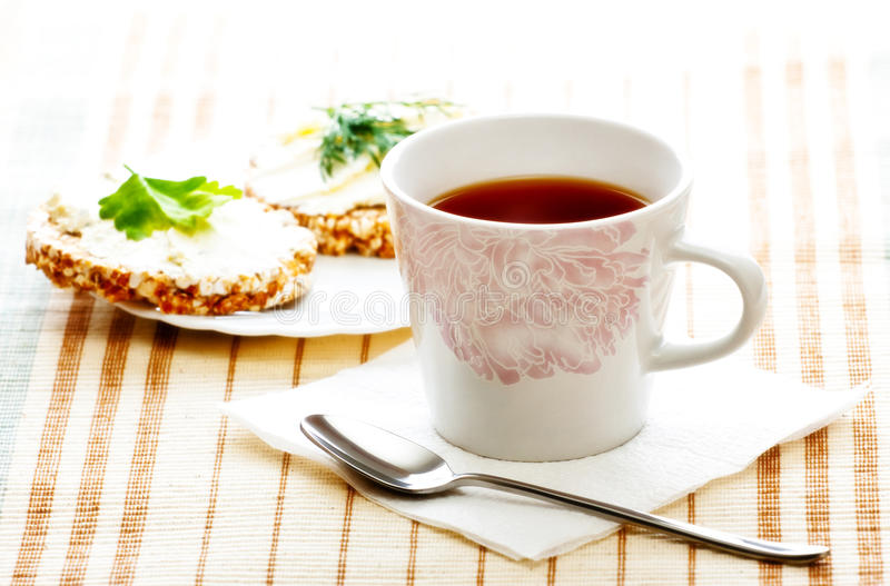 Diet breakfast with tea and corn bread royalty free stock photo