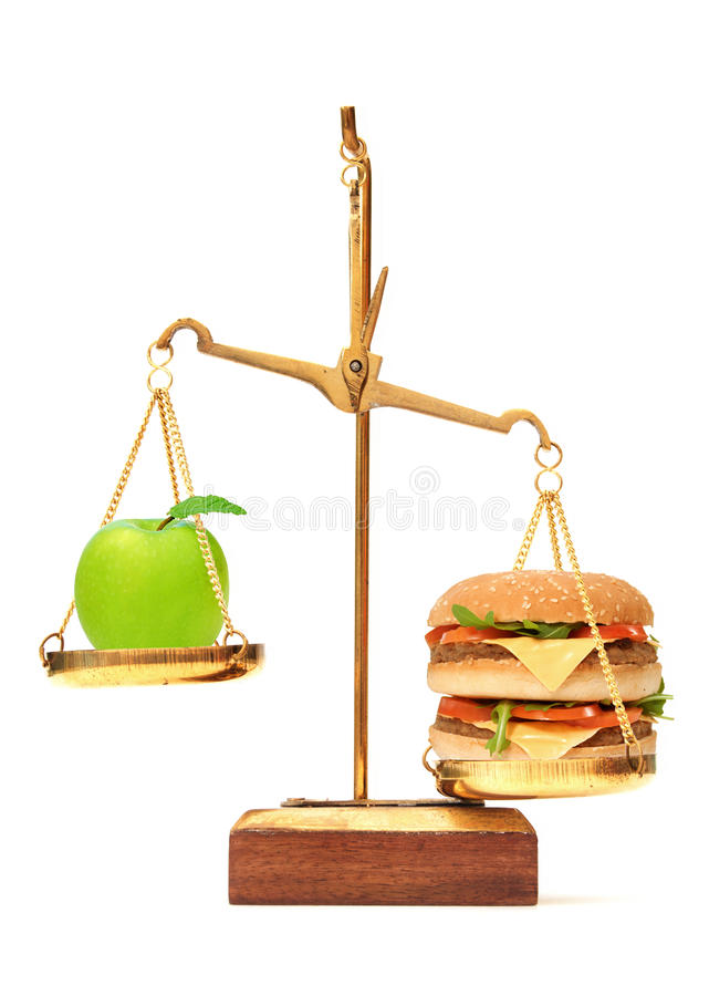Diet choice between apple and burger royalty free stock images