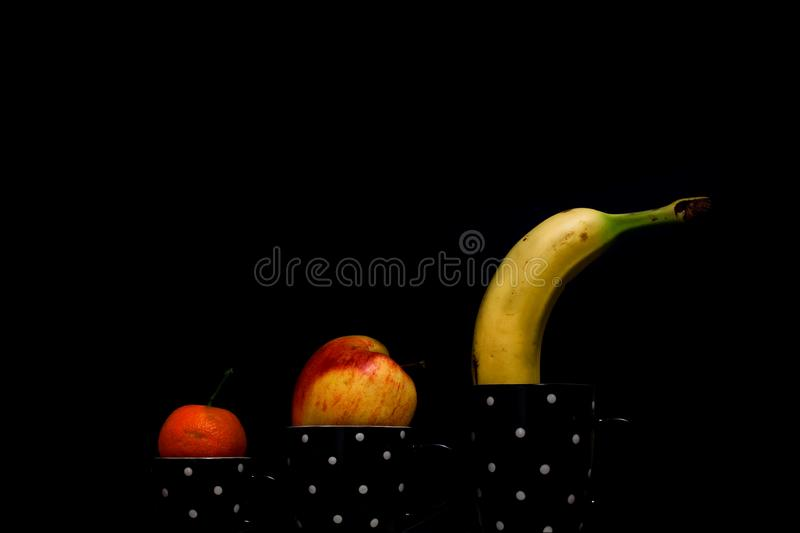 Fruit cup with a black background royalty free stock images