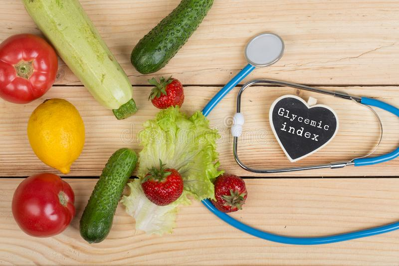 Diet concept - Blackboard in shape of heart with text Glycemic index, stethoscope, vegetables, fruits and berries. Good healthy and diet concept - Blackboard in royalty free stock photos