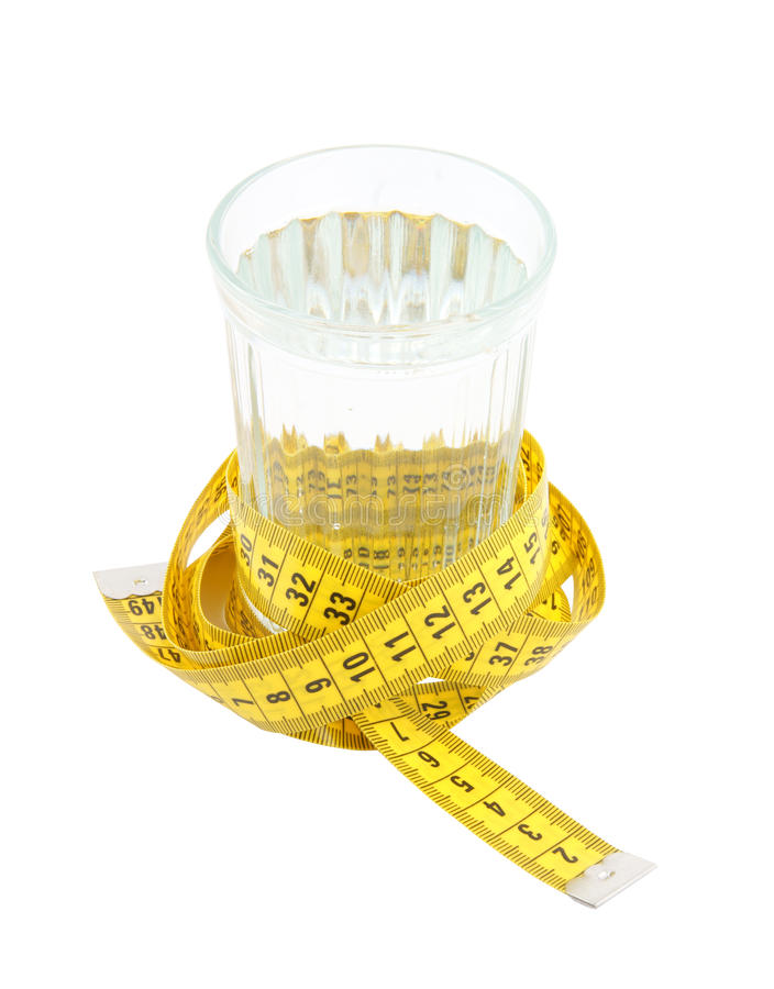 Diet concept, glass of water and measuring tape royalty free stock images
