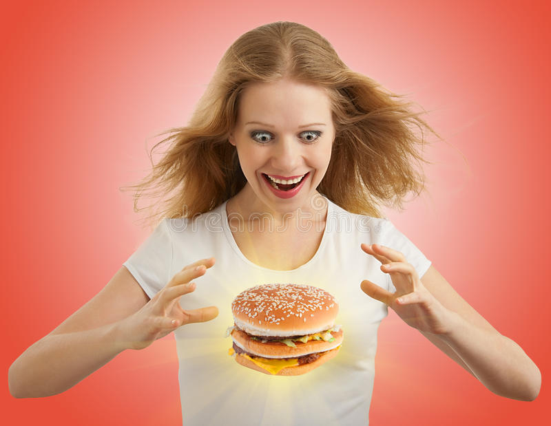 Diet concept. Happy girl, magic hamburger royalty free stock image