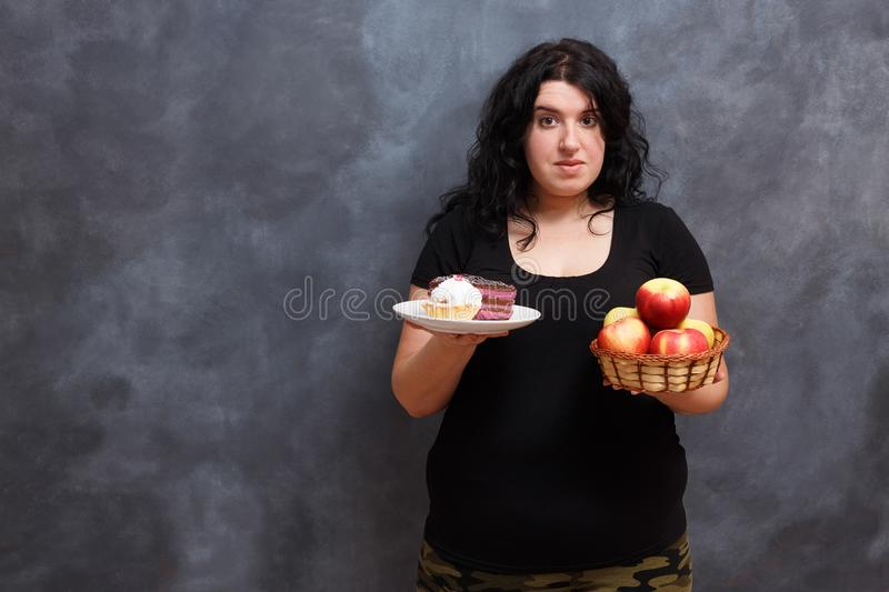 Diet, dieting concept, healthy food. Beautiful young overweight stock image