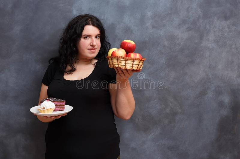 Diet, dieting concept, healthy food. Beautiful young overweight royalty free stock photos