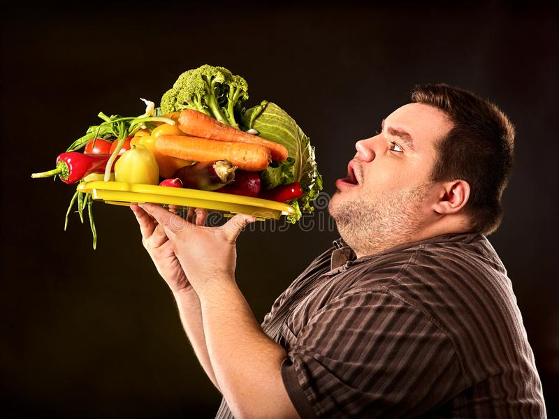 Diet fat man eating healthy food. Healthy breakfast with vegetables. Diet fat man eating healthy food with vegetables for overweight male. Hungry person ready royalty free stock image