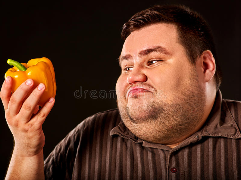 Diet fat man eating healthy food. Healthy breakfast with vegetables. Diet fat man eating healthy food. Health breakfast with vegetables cauliflower and sweet royalty free stock photo